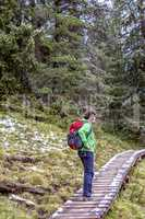 Woman hiking in the nature park Geisler-Puez in South Tyrol