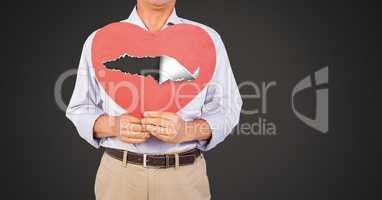 Man holding hurt love heart with torn paper