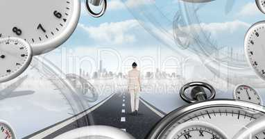 Businesswoman walking on road with surreal time clocks perspective