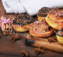 round baked buns with poppy seeds and with nuts