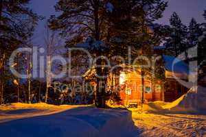 Early Morning and Log House in the Winter Forest