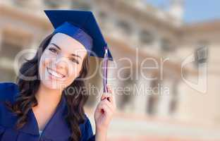 Happy Graduating Mixed Race Woman In Cap and Gown Celebrating on