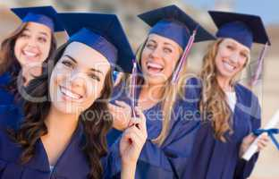 Happy Graduating Group of Girls In Cap and Gown Celebrating on C