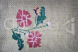 Craft: embroidered cross-stitch flowers beautiful.