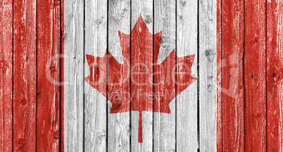 National flag of Canada on old white wood background
