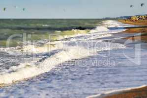 Large foamy waves crash on a beach