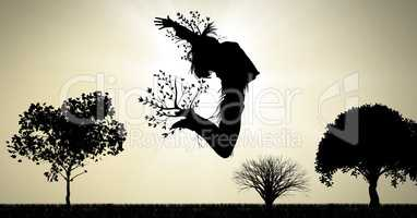 Woman surreal jumping expression with tree branches connected to nature