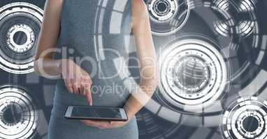 Woman holding tablet with circle interface