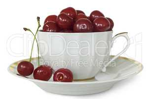 White Cup and saucer with cherries on a white background.