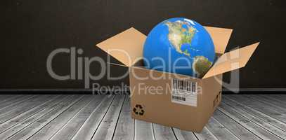 Composite 3d image of computer graphic image of globe in cardboard box
