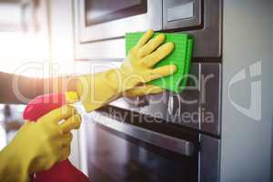 Cropped image of hand cleaning house chores