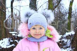 Portrait of baby in amusing winter cap