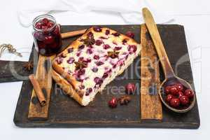 pie from cottage cheese and cherries on a brown board
