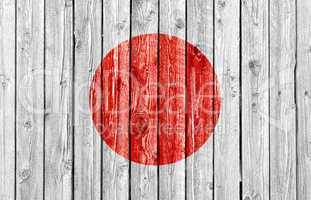 National flag of Japan on old wood background