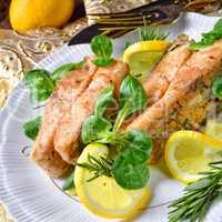 Fried carp fillet on wintry salad