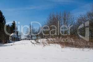 Winter landscape with chapel