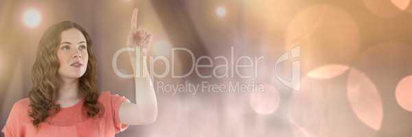 Businesswoman touching light glow