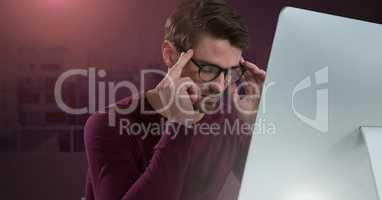 Businessman working on laptop with red crimson background