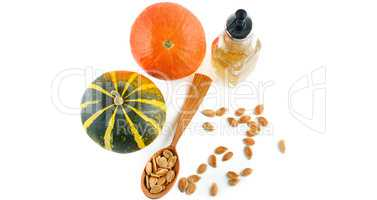 Oil, seeds and pumpkin fruits isolated on white background. Wide