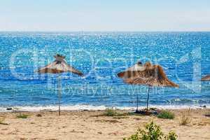 Straw beach parasols