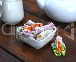 Turkish delight with nuts in a ceramic bowl