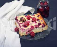 piece of cheesecake with cherry berries
