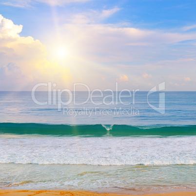 Beautiful seascape and sun on blue sky .