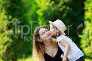 Child kisses his mother