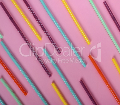 colorful plastic tube with white polka dots