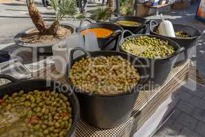 Green olive on the market in the street in town Palamos