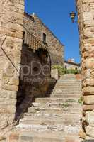Beautiful old stone stairs in Spanish ancient village, Pals, in Costa Brava