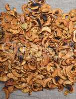 dried apple slices on gray fabric, top view