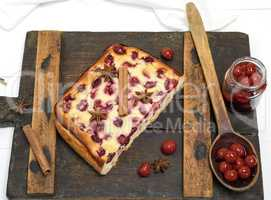 cottage cheese and cherry pie on a brown wooden board