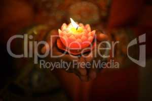 Diwali oil lamp with hands