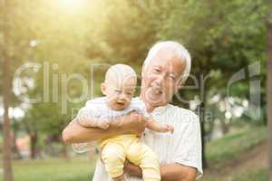 Grandfather and grandson at the park.