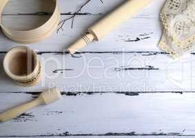 wooden rolling pin and a wooden round sieve