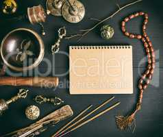 Asian religious musical instruments for meditation and notebook