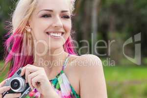 Woman With Blond and Magenta Pink Hair Using Camera