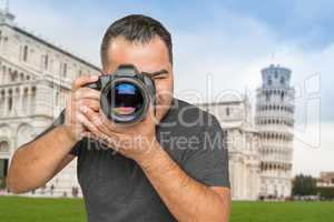 Hispanic Male Photographer With Camera at Leaning Tower of Pisa