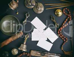 empty white business cards in the midst of Asian religious objec