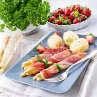 asparagus ham rolls with strawberries and hollandaise