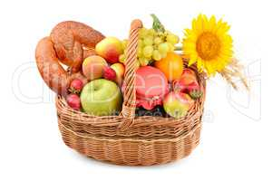 A set of fruits and pastries in a woven basket isolated on white