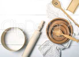 wooden round plates, sieve and rolling pin