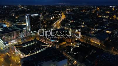 Aerial view of the night city with traffic on the roads and nightlife