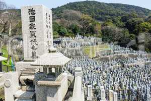 Old stone graves and headstones at a Buddhist cemetery in Japan