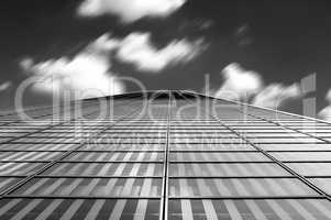 Modern architecture abstract with clouds in motion blur