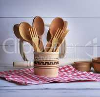 wooden spoons and forks in a wooden container
