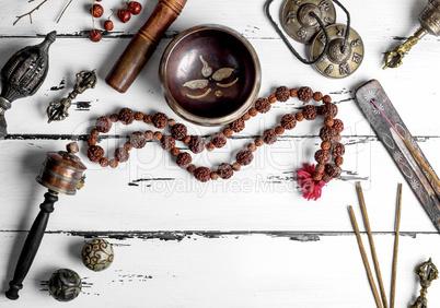 Copper singing bowl, prayer beads, prayer drum, stone balls and