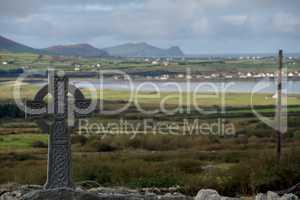 Celtic cross with irish landscape