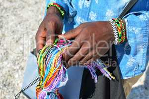 Colorful string in black man's hands